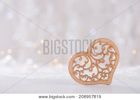 Wooden Ornate Heart With Garland Lights On Background