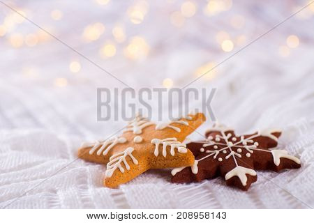 Christmas Glazed Cookie In Form Of Star And Snowflake On Light And Warm Bokeh Background