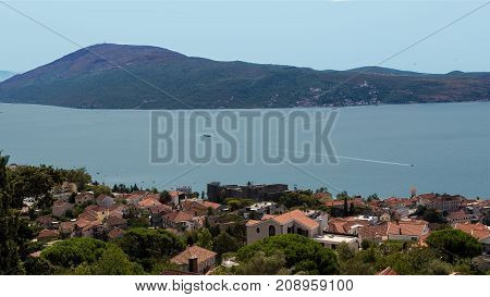 Herceg Novi Montenegro. Detailed panoramic shot. Beautiful top view on the town. Bay of Kotor (Boka Kotorska). Sea and mountain background.