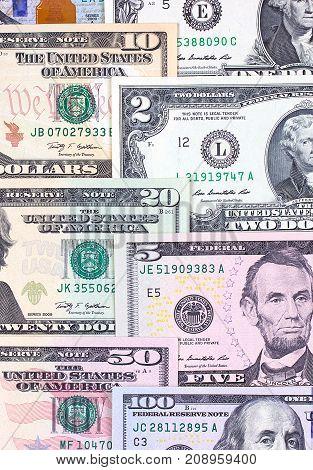 Abstract American Dollar Bills Of Different Denomination Background.