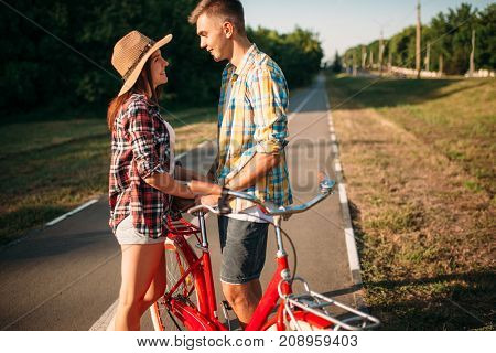Love couple with vintage bicycle walking in park