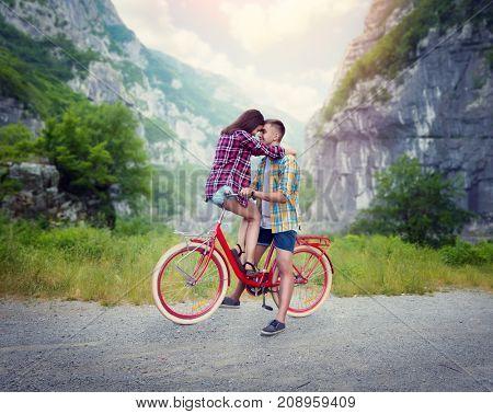 Boyfriend and girlfriend kissing on retro bike