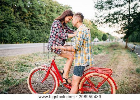 Man and woman kissing on retro bike