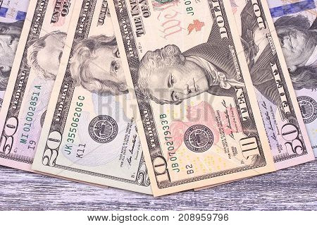 Money Dollars On Gray Wooden Background. Space.