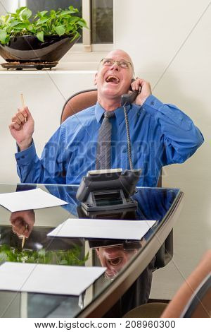 Businessman In Office On Phone