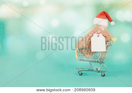 Gifts And Shopping Cart And Santa Red Hat.