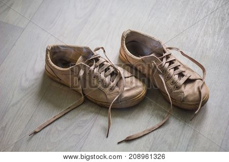 old female stinky sneakers on the floor