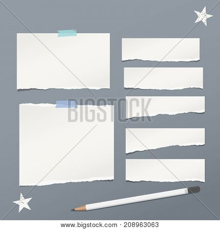 White ripped lined note, notebook paper for message or text stuck with sticky tape on gray background with stars and pencil
