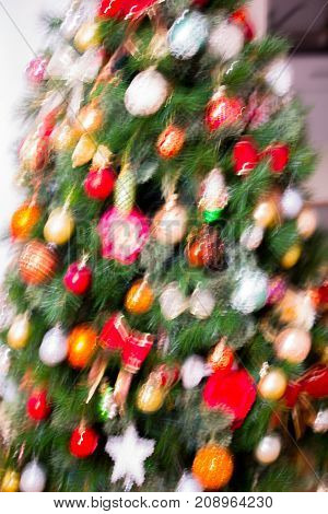 Christmas decoration with red berries, cones and toys, Blurred image for background
