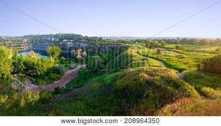 Panoramic landscape - a flooded quarry in the city of Krivoy Rog in Ukraine