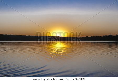 Autumn landscape: the sunset and its reflection in shallow waters of the Gulf landscape: the sunset and its reflection in shallow waters of the Gulf