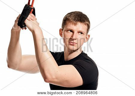 Portrait of young fit healthy man doing expander exercise