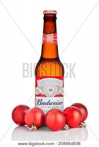 London, Uk - October 14, 2017:: Bottle Of Budweiser Beer On White With Christmas Decoration Balls, A