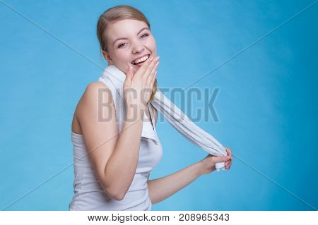 Attractive Woman Holding Big White Towel And Laughing