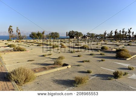 Abandoned parking in Ein Gedi national park after Dead Sea catastrophic drying Israel