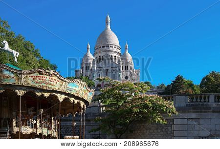 The basilica Sacre Coeur is a Roman catholic church located at the summet of the butte Montmartre , the highest point in Paris.
