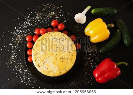 Gourmet cheese. Healthy homemade food. Quality sort of Caciotta with herbs and vegetables around, upmarket concept, top view