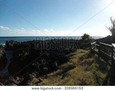 Great view of black Vulcan beach on Reunion island