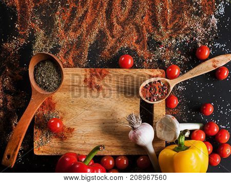 Spices. Culinary, cuisine, recipe background. Variety of vegetables on black table, free space and closeup. Menu, blog concept