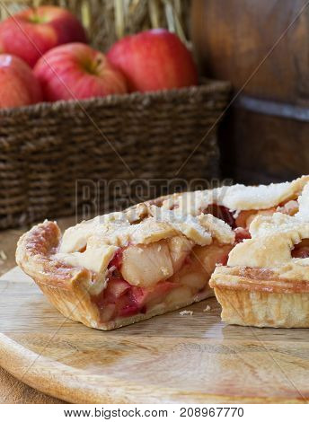 Slice of apple cranberry pie on a wooden platter