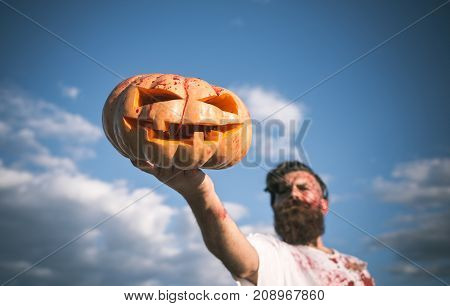 Halloween Jack O Lantern With Red Blood In Zombie Hand