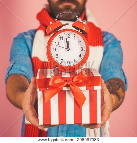 Christmas Alarm Clock On Present Box In Male Hands