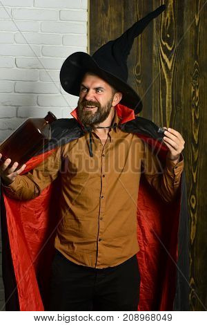 Halloween Man Magician Conjuring Trick With Bottle