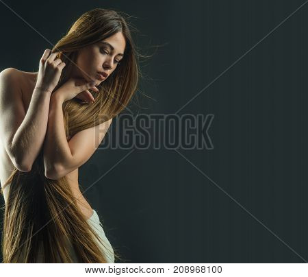 Woman With Long Healthy Hair And Naked Chest