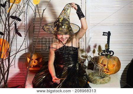 Girl With Tricky Smiling Face On Spooky Carnival Room Background