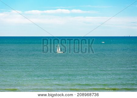 Boat in blue water and boat fishing in Mediterranean sea.