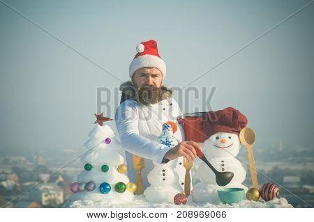 Sad Man In Santa Hat Ladling Soup On Winter Day