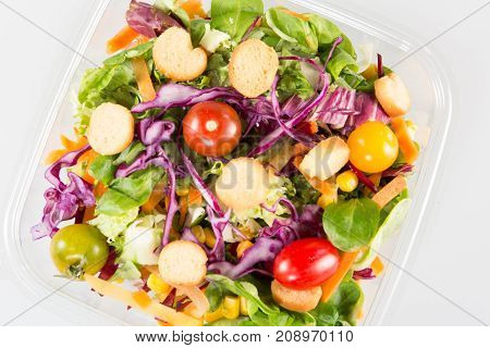 Salad In Takeaway Container From Top On White Background