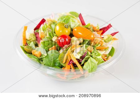 a large Takeaway salad on white background