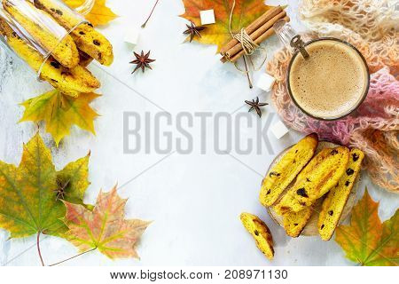 Freshly Baked Raisins And Cinnamon Biscotti And A Cup Of Cappuccino Coffee On A Gray Slate Or Slate