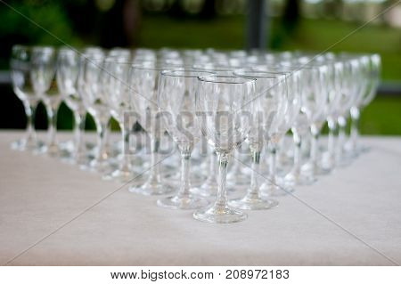 Empty Glasses Arranged On A Table In The Restaurant, Cafe, Or Bar. Preparation For The Birthday, Wed