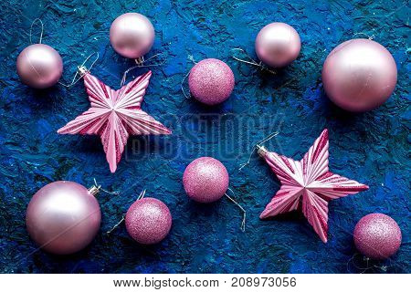 New year decoration. Christmas balls and stars on blue table background top view pattern