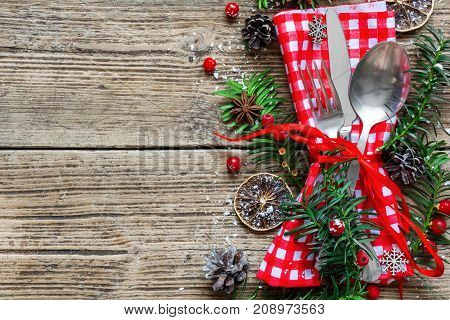 Christmas table place setting with christmas pine branchesribbon dried oranges and cones. Christmas holidays background. top view with copy space