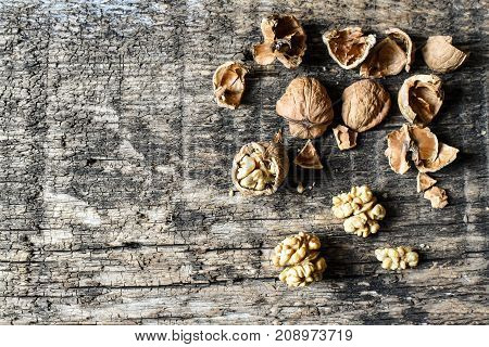 Delicious Nuts And Nutcrackers On An Old Wooden Table, Copyspace, Set