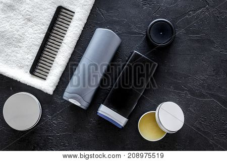 Cosmetics for men on black background top view.
