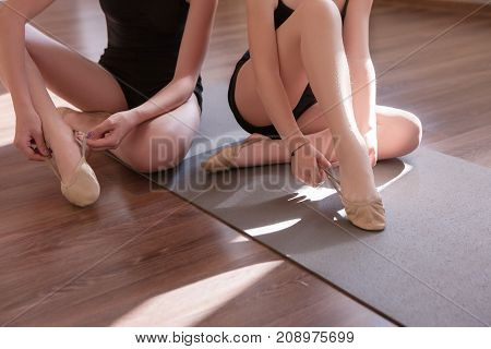 Sensitive females. Young ballerinas lesson. Unrecognizable ladies in dance class, sensibility from childhood. Gym background with free space, healthy lifestyle, teen ballet concept