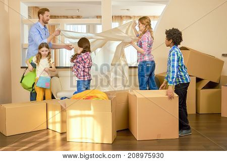 Parents and kids, relocation. People and boxes indoors. Low price apartments for rent.
