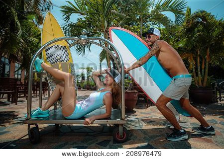 Boy and girl surfers having fun with surfboards
