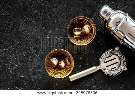 Barmen set on the bar with whiskey cocktails, shaker on black background top view mock-up