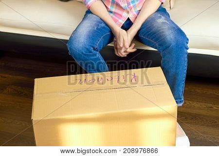 Cardboard box indoors. Person gets ready for relocation.
