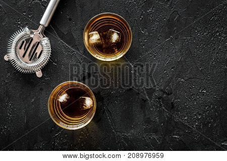Barmen set on the bar with whiskey cocktails, tools on black background top view mock-up