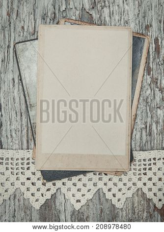 Vintage Background With Old Photos On Wood With Lace