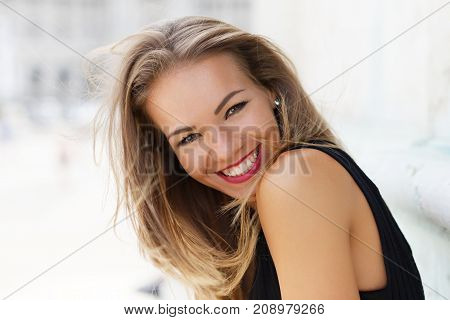 Happy young brunette carefree woman smiling outdoor portrait happiness