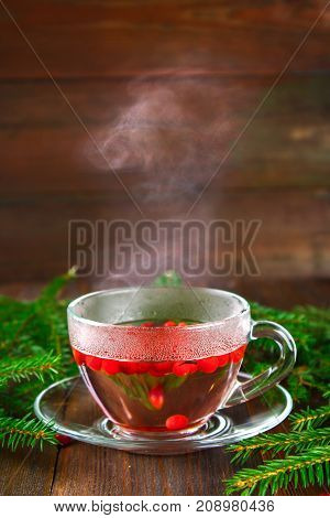 Hot Lingonberry, Cranberry, Foxberry, Cowberry Tea In Glass Cup, Rustic Background