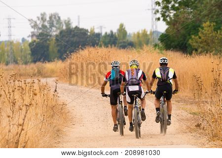 Mountain bikers on old rural road with copy space
