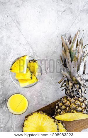 Sliced pineapple on grey background top view.